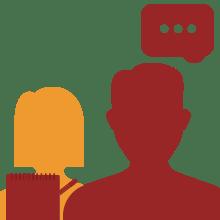 Persona hablando y otra escribiendo